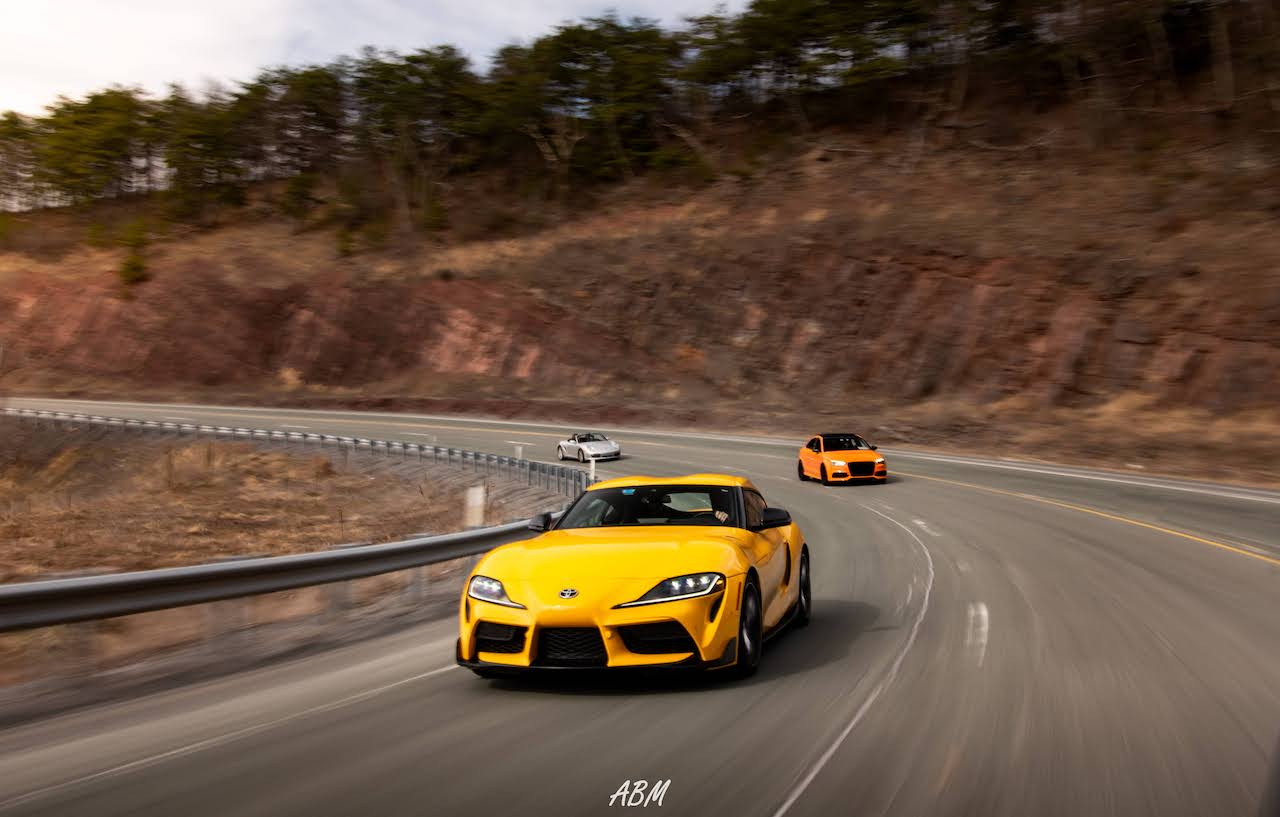 Nitro Yellow 2021 Toyota Supra and Glut Orange Audi S3 and Porsche Boxster S